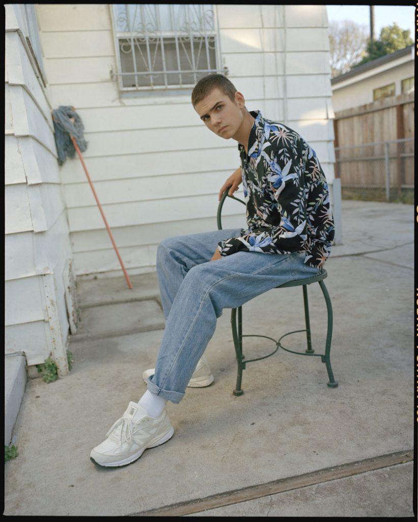 Stüssy x New Balance 990v4 - On feet light blue ankle jeans