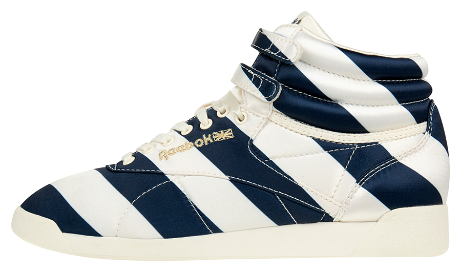 0bb3152b553 ... Reebok Classic Freestyle Hi model in Satin Stripe creates an  interesting effect by blending navy blue and creme white in a bold stripe  pattern.