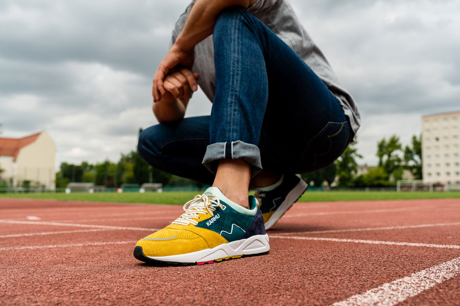 Karhu Legend Track Field Pack - Aria (June Bug Green Sulphur) - On feet